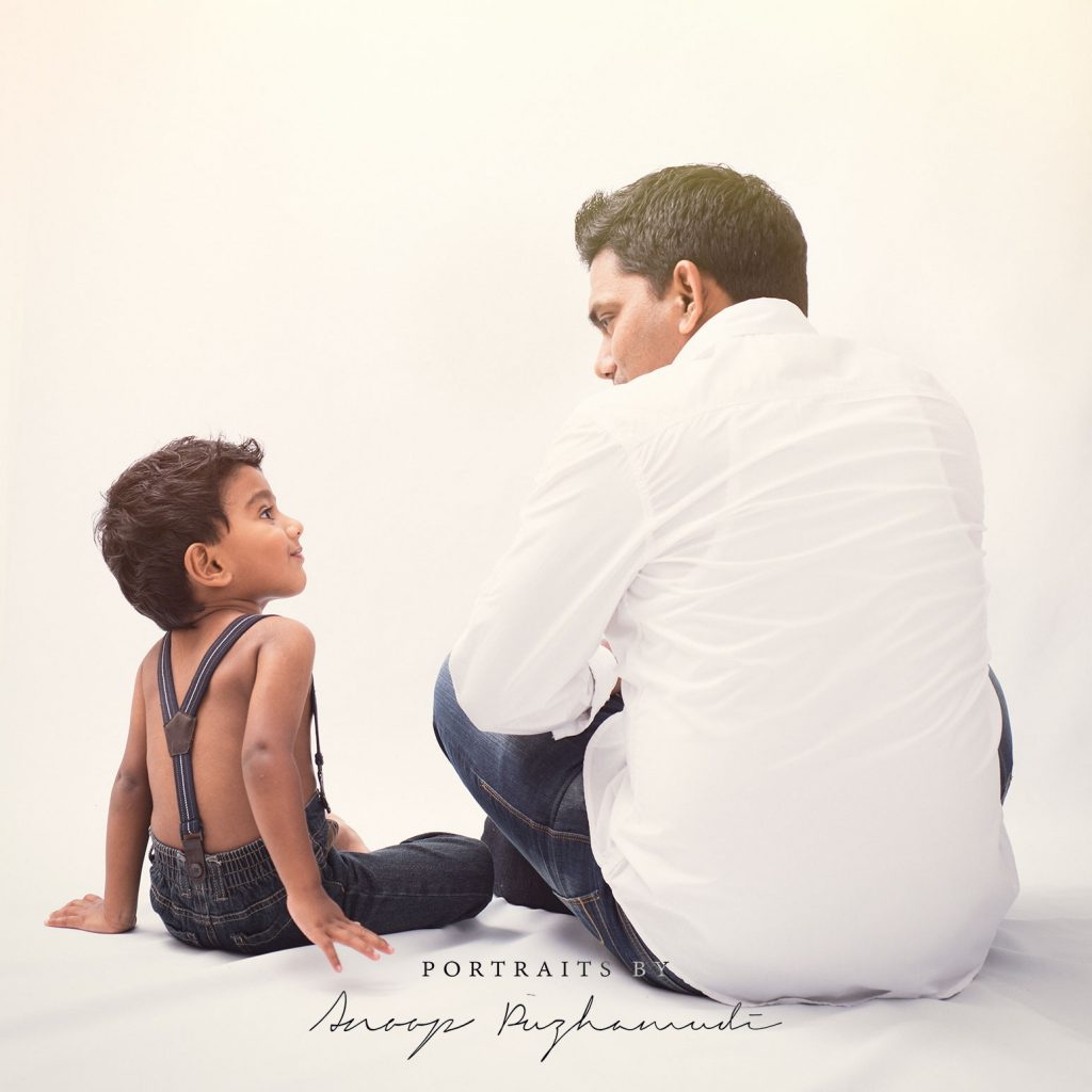 Father and son in a white background